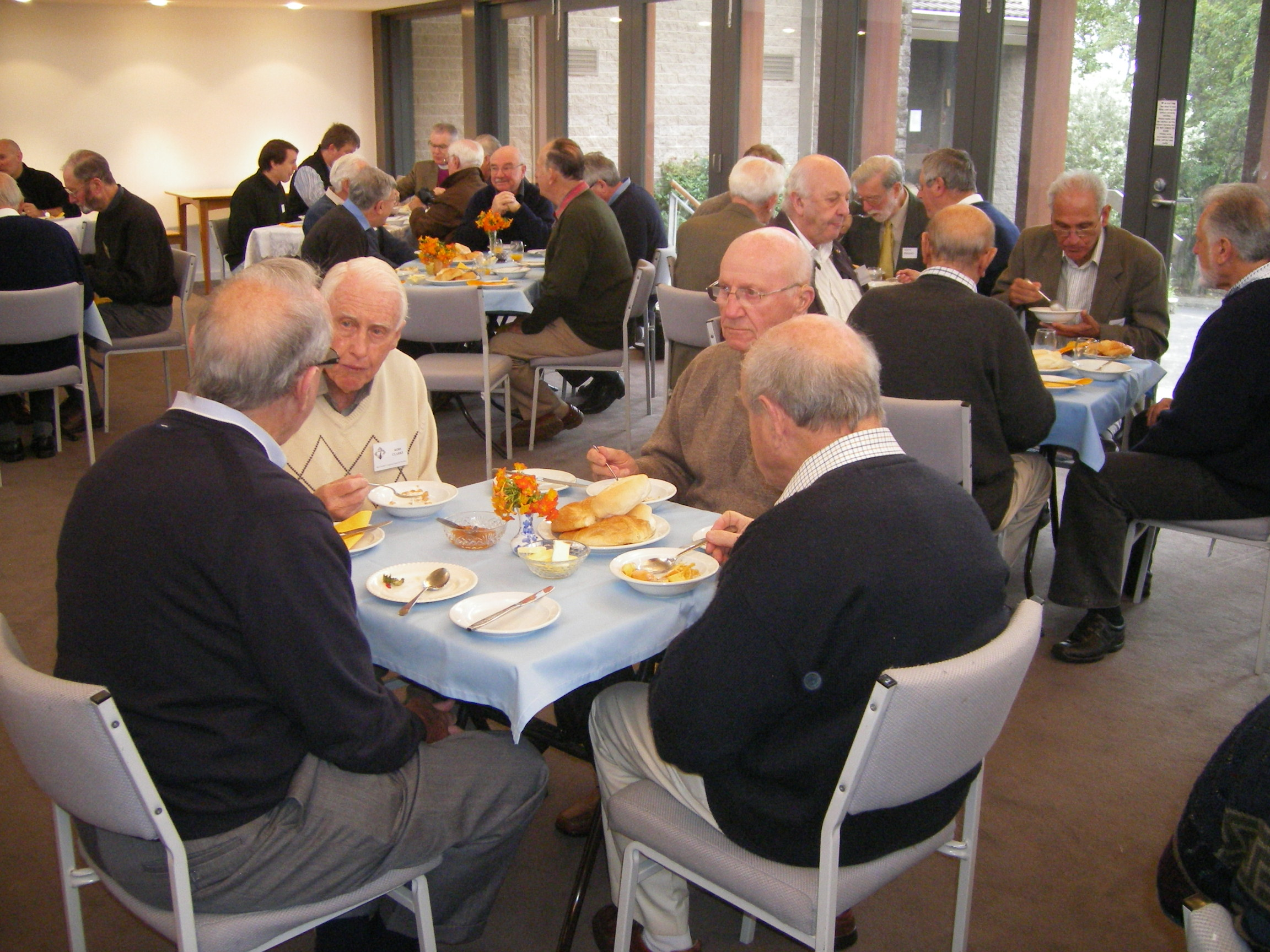 Some of the men of the parish enjoy breakfast together